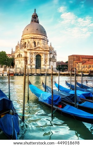 Grand Canal and Basilica Santa Maria della Salute in Venice early in the morning. This image is toned. - stock photo