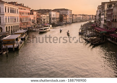 Grand Canal in Venice, Italy at sunset with gondolas - stock photo