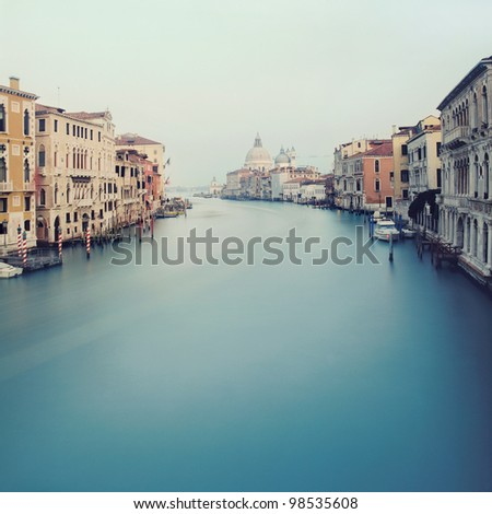Grand Canal in Venice - view from the Acedemy bridge with Basilica di Santa Maria della Salute background - stock photo