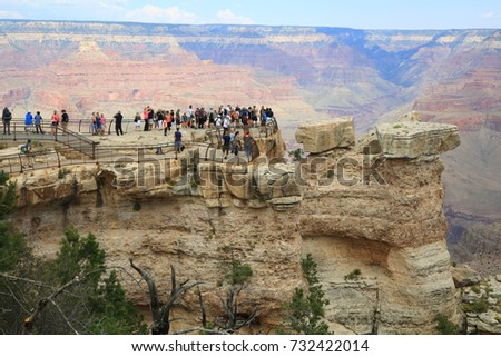 "Grand Canyon, Arizona, USA - September 11, 2017: Tourists at Mather Point, Grand Canyon. ""Grand Canyon"" was officially designated a national park on February 26, 1919"