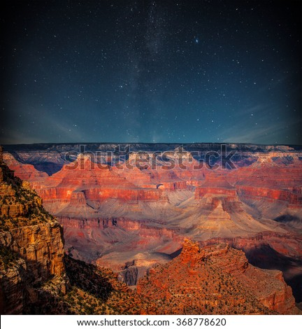 Grand Canyon at night under the light of the stars in the sky - stock photo