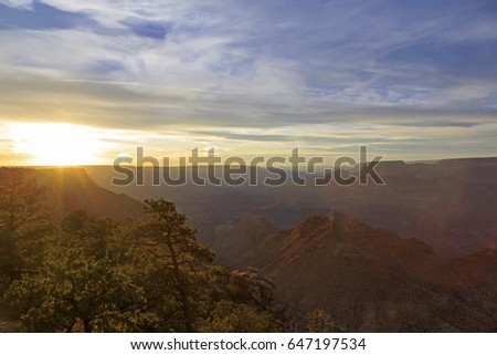 Grand Canyon at the sunset with colorful cliffs and sun rays, Colorado river, Arizona, USA
