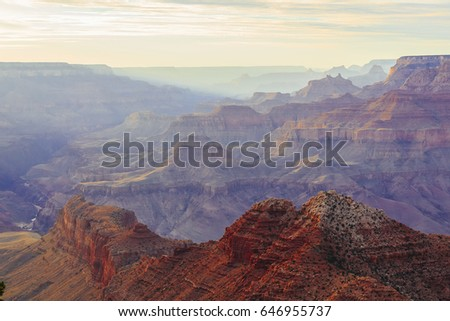 Grand Canyon at the sunset with colorful cliffs, Colorado river, Arizona, USA