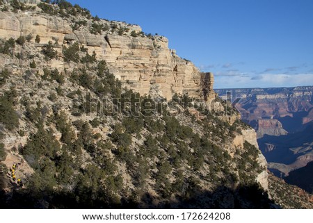 Grand Canyon National Park, Arizona - sunrise on the Bright Angel trail with tourists on mule ride - stock photo