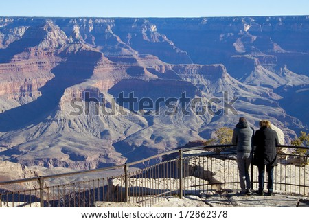 Grand Canyon National Park, Arizona - tourists at scenic overlook, morning on the south rim. - stock photo