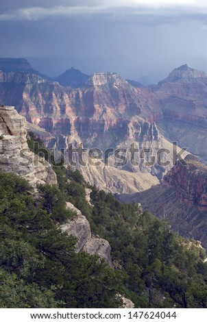 Grand Canyon National Park, AZ one of the wonders of the world as seen from the north rim/ Grand Canyon/Summer storms hit the north rim and change the look of the canyon, making it an exciting show. - stock photo