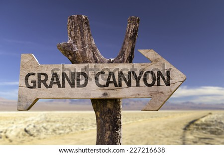 Grand Canyon wooden sign with a desert background - stock photo