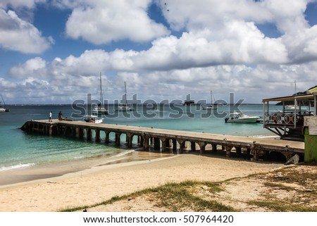 GRAND CASE -  AUGUST 02:  Pier and beach view in small town Grand Case seen in St.Martin/St.Maarten on August 2, 2015