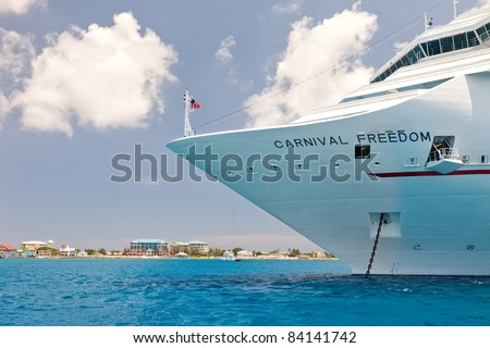 GRAND CAYMAN, CAYMAN ISLANDS  - JULY 13:  A cruise ship anchors near Grand Cayman and is required to tender visitors to the port on July 13, 2011.  Grand Cayman is the capital of the Cayman Islands. - stock photo