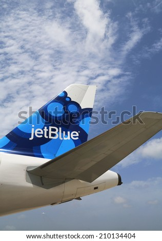 GRAND CAYMAN, CAYMAN ISLANDS - June 13  JetBlue Airbus A320 blueberries-inspired design tailfin  at Owen Roberts International Airport at Grand Cayman on June 13, 2014 - stock photo
