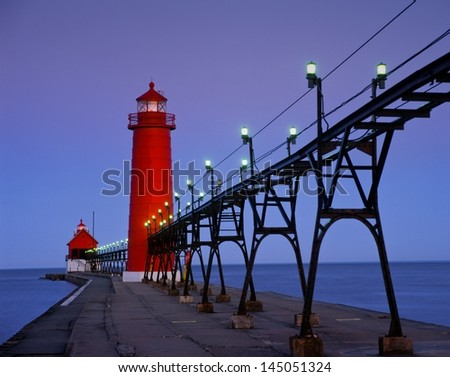 Grand Haven Lighthouse at sunrise - stock photo