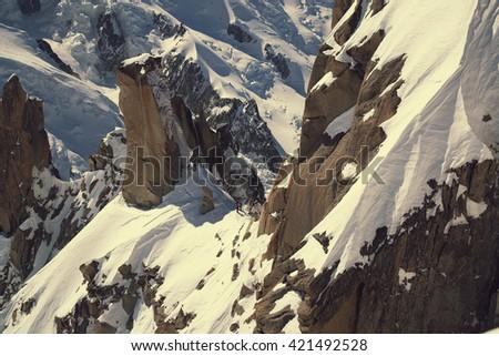 Grand Jorasses and freeriders, extreme ski, Aiguille du Midi, French Alps - stock photo