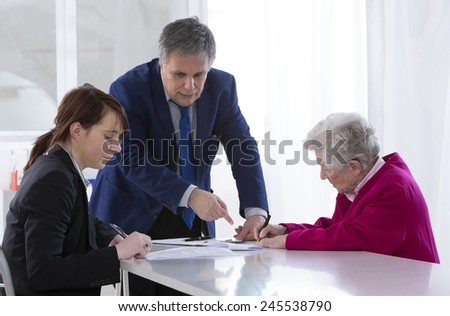 Grand mother signing insurance contract and donation to her grand daughter