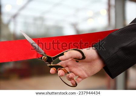 Grand opening, cutting red ribbon - stock photo