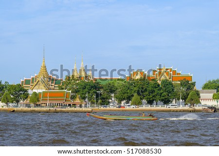 Grand palace and Wat phrakeaw temple the famous travel destination in Bangkok Thailand near Chao Pra Ya river and local speed boat river taxis.