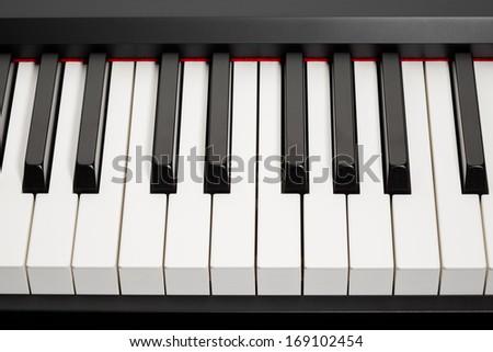 grand piano ebony and ivory keys, closeup view - stock photo