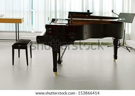 Grand piano in hall - stock photo