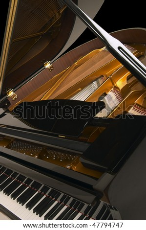 Grand piano inside view isolated on black - stock photo