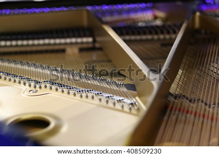 Grand piano strings and hammers with beige rim - stock photo