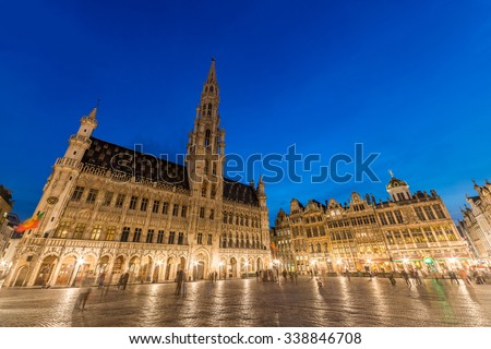 Grand Place, Brussels. Wide angle night scene sunset, The Town Hall (Hotel de Ville) is dominating the composition with its 96m tall spire. Belgium
