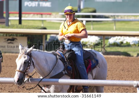 GRAND PRAIRIE,TX - JUNE 6th:  A horse trainer is resting after race at Lone Star Park Horse Race June 6th, 2009 in Grand Prairie, Texas. - stock photo