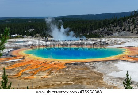 Grand Prismatic Springs Yellowstone National Park high angle view. Beautiful hot springs vivid color blue green orange in Wyoming. People visit the gorgeous famous nature during summer.