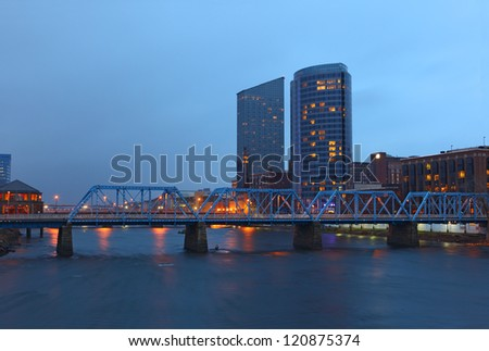 Grand Rapids cityscape by twilight night in Michigan - stock photo
