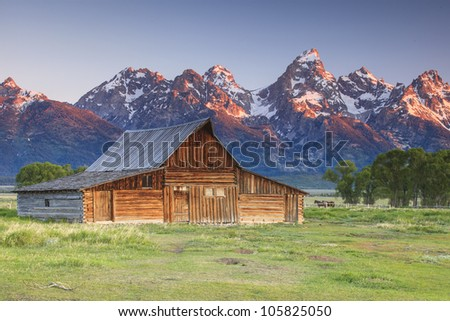 Grand Teton and old ranch in Wyoming - stock photo