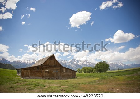 Grand Teton mountain barn with mountains in background