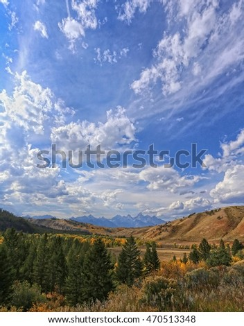 Grand Teton National Park in Wyoming a Distant View with Fall Colors and Clouds