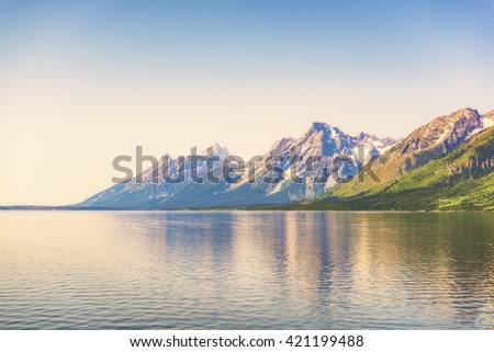 Grand teton with reflection on the river,Wyoming,usa. - stock photo