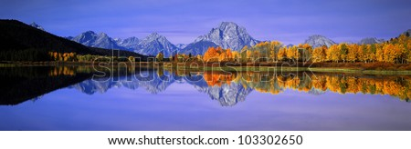 Grand Tetons and reflection in Grand Teton National Park, Wyoming - stock photo