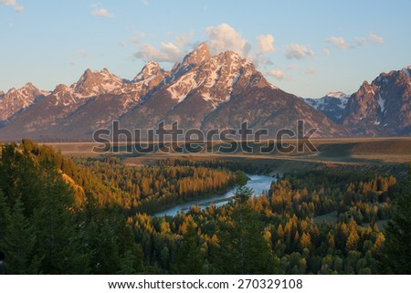 Grand Tetons peak at sunrise with snake river overlook in Wyoming, US - stock photo