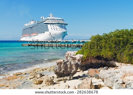 GRAND TURK, TURK AND CAICOS - FEBRUARY 5, 2015: Royal Princess brings passengers to the Cruise Center for a day of fun and relaxation. This island is a very popular tourist destination.