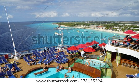 GRAND TURK, TURKS AND CAICO - NOV 23: Carnival Breeze sailing away from Grand Turk, Turks and Caicos Islands, on Nov 23, 2015. It is a Dream-class cruise ship which entered service on June 3, 2012. - stock photo