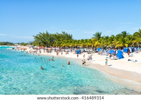 GRAND TURK, TURKS AND CAICOS - FEBRUARY 5, 2015: Tourists enjoy the facilities at this Cruise Center during a schedule stopover.