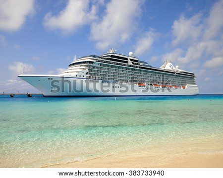 GRAND TURK, TURKS AND CAICOS ISLANDS : MARCH 26, 2011: OCEANIA MARINA Cruise ship (Oceania Cruises) anchored in Grand Turk,Turks and Caicos Islands, the Caribbean on march 26th, 2011 - stock photo