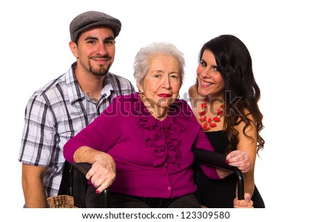 Grandchildren with their elderly handicapped grandmother on a white background. - stock photo