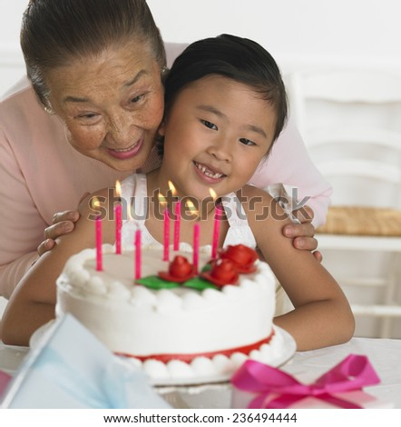 Granddaughter and Grandmother Celebrating Birthday - stock photo