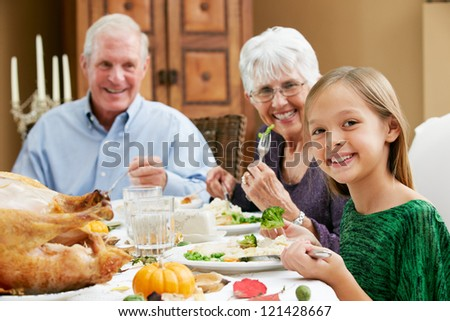 Granddaughter Celebrating Thanksgiving With Grandparents