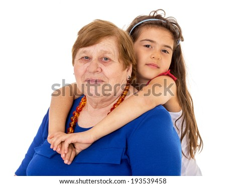 Granddaughter hugs grandmother
