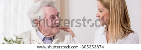 Granddaughter is taking care of her grandfather  - stock photo