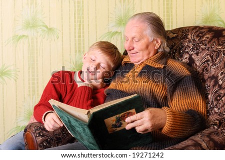 grandfather and boy with album