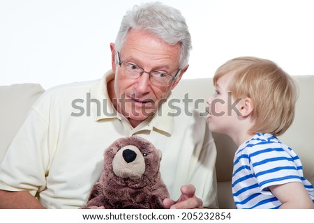 grandfather and child whisper - stock photo