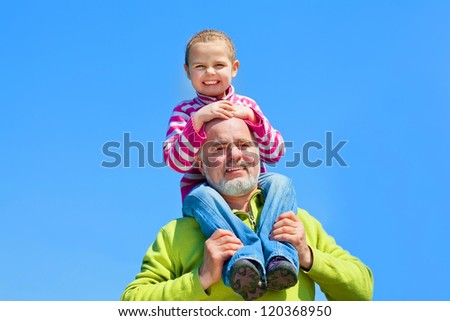 Grandfather and  granddaughter happy together - stock photo