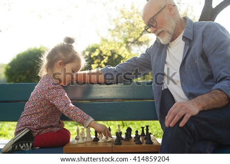 Grandfather and granddaughter spending time together - stock photo