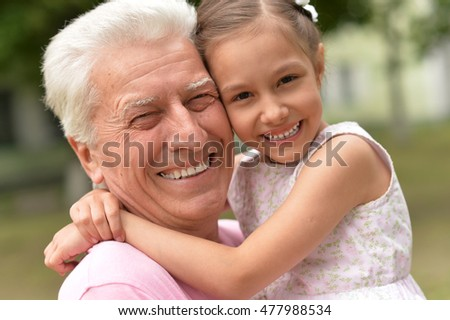 Grandfather and granddaughter together