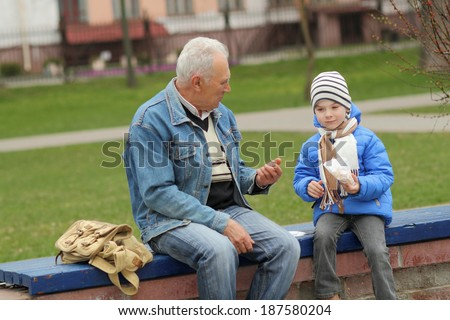 Grandfather and grandson eating fries and indulge. Grandfather and grandchild - stock photo