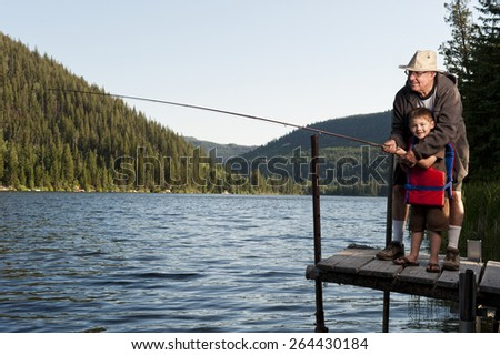 Grandfather and Grandson Fishing Together - stock photo