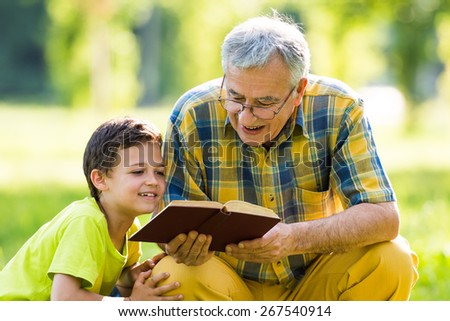 Grandfather and grandson learning about nature - stock photo